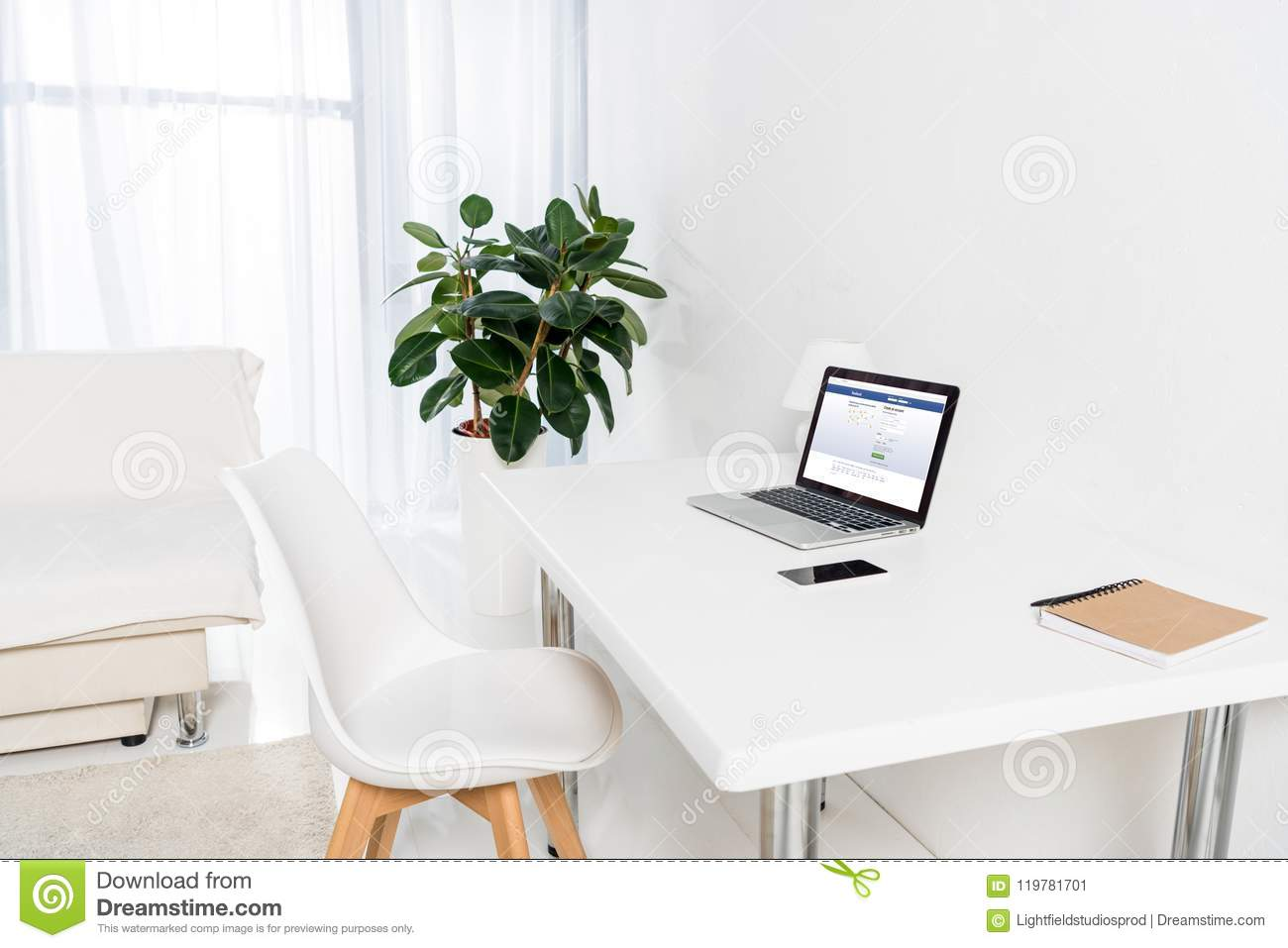 Home Office With Laptop With Facebook Logo, Smartphone And Notebook ...
