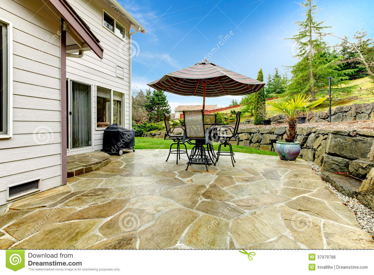 Home patio area overlooking beautiful landscaping royalty for Patio and terrace