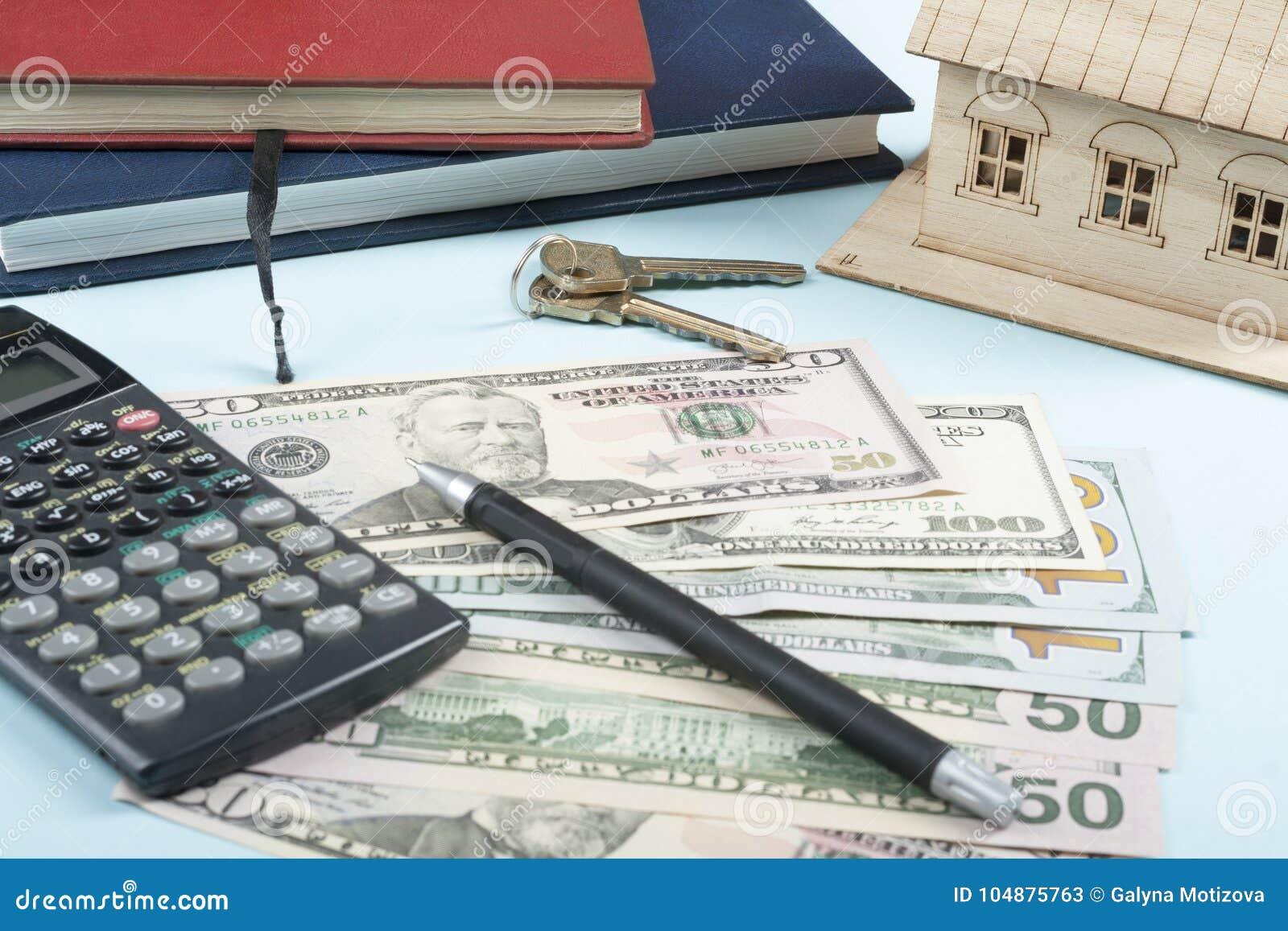 home savings budget concept model house notepad pen calculator