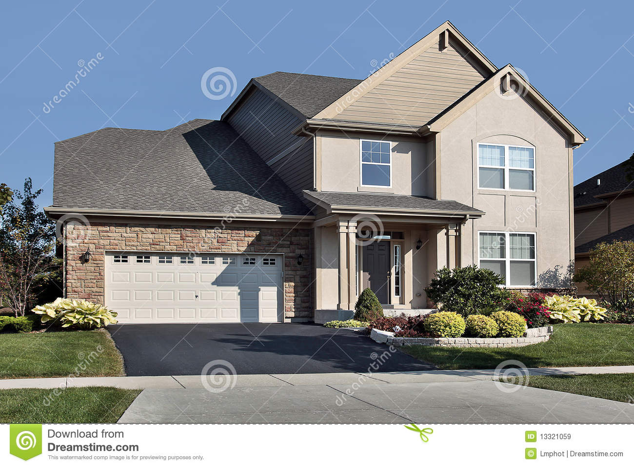 Home with stone garage and covered entry stock image for Garage con soffitta