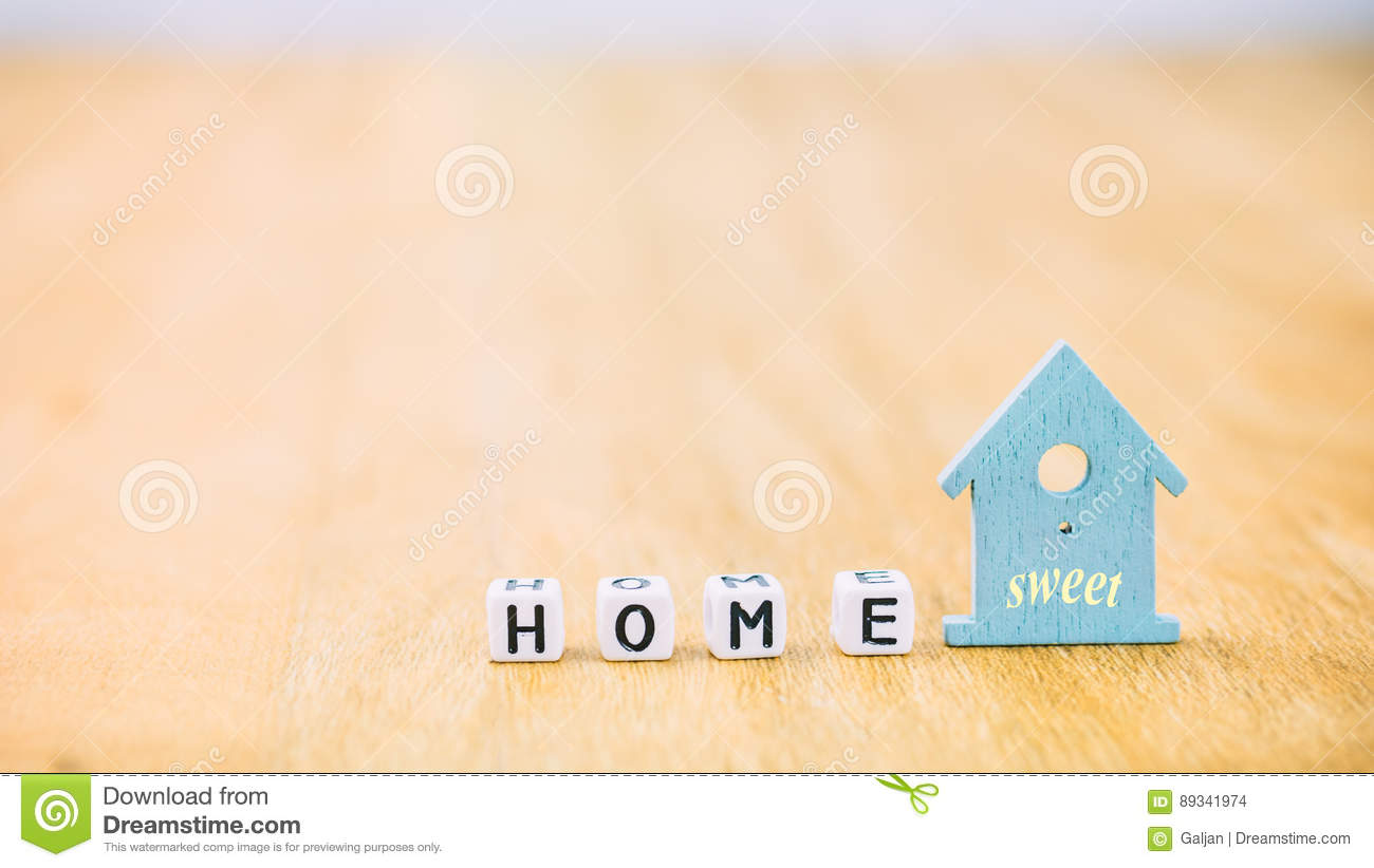 HOME Sweet Horizontal Word Of Cube Letters Behind Blue House Symbol
