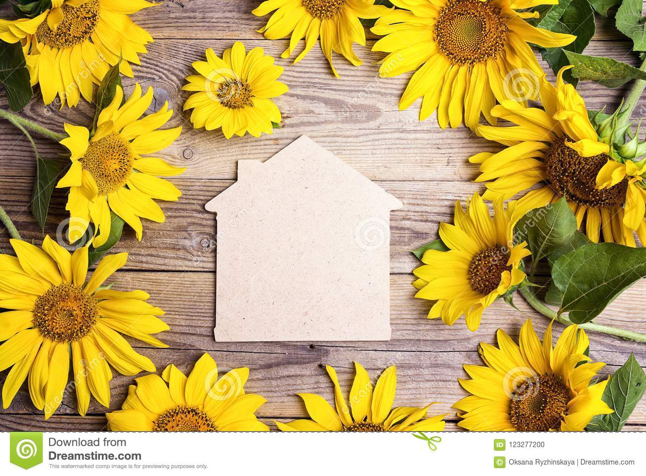 Home Symbol With Yellow Sunflowers On A Old Wooden Backgrounds