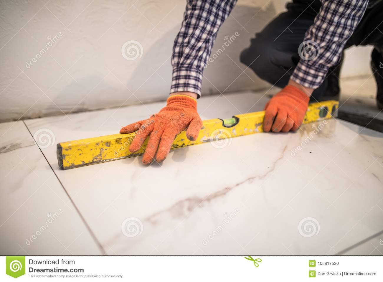 Home Tile Improvement Handyman With Level Laying Down Tile Floor