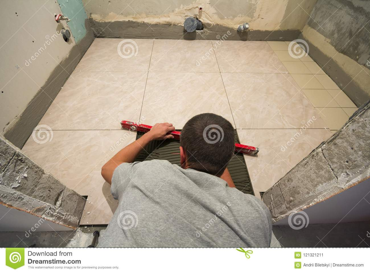 Home Tiles Improvement Handyman With Level Laying Down Tile Floor