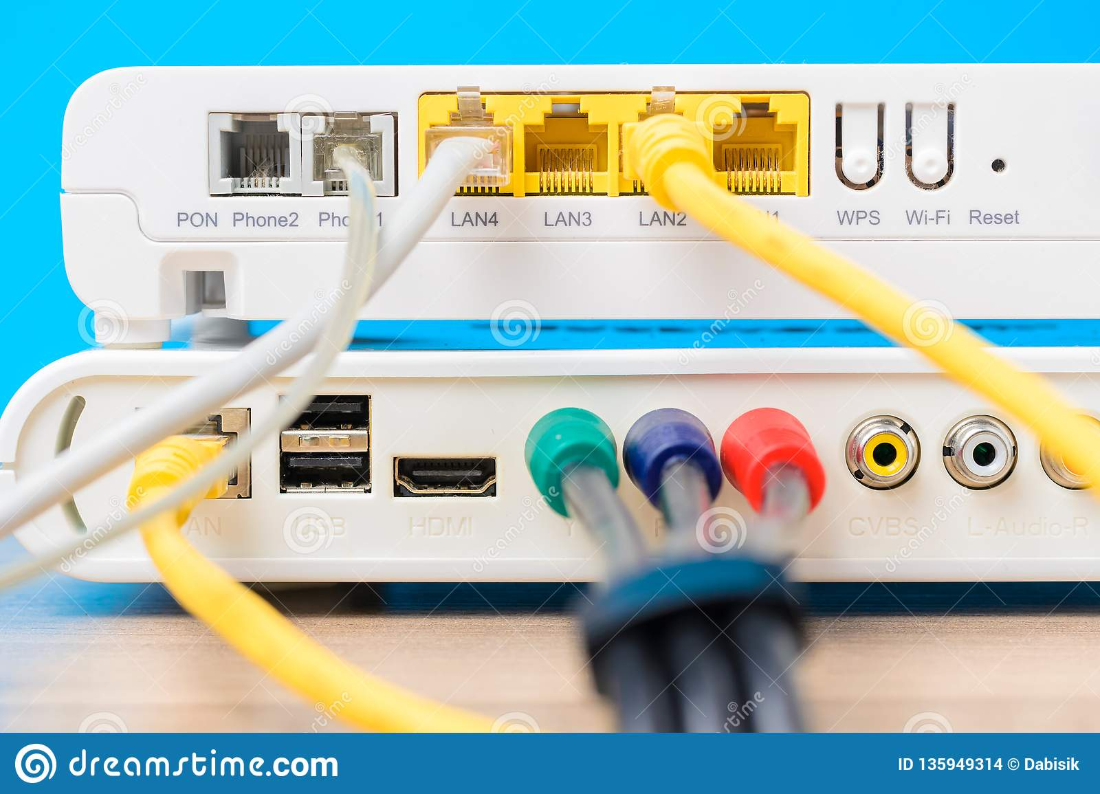 Home Wireless Router With Ethernet Cables Plugged In On Blue