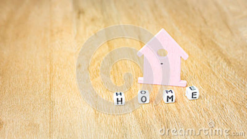 Home Word Of Cube Letters In Front Of Lilac Coloured House Symbol On