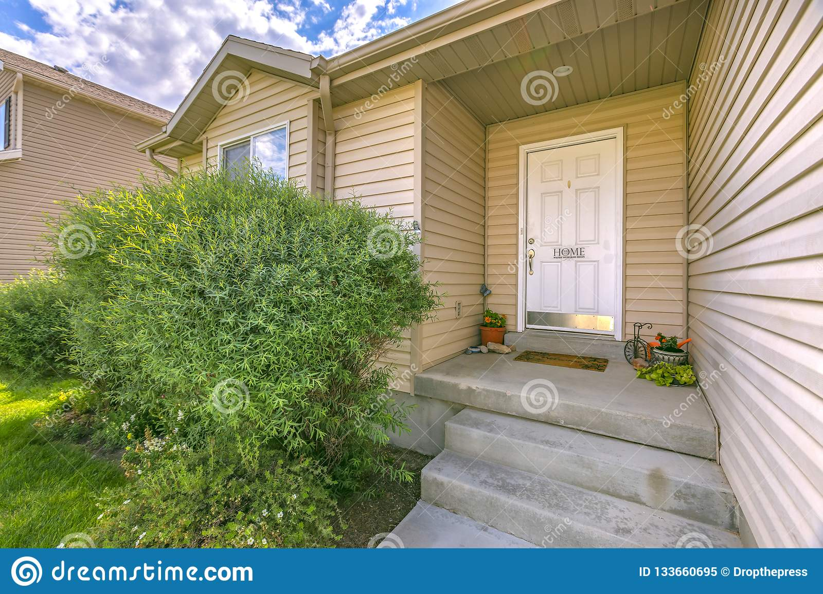 Home With Yard And Stairs Leading To Front Door Stock Image