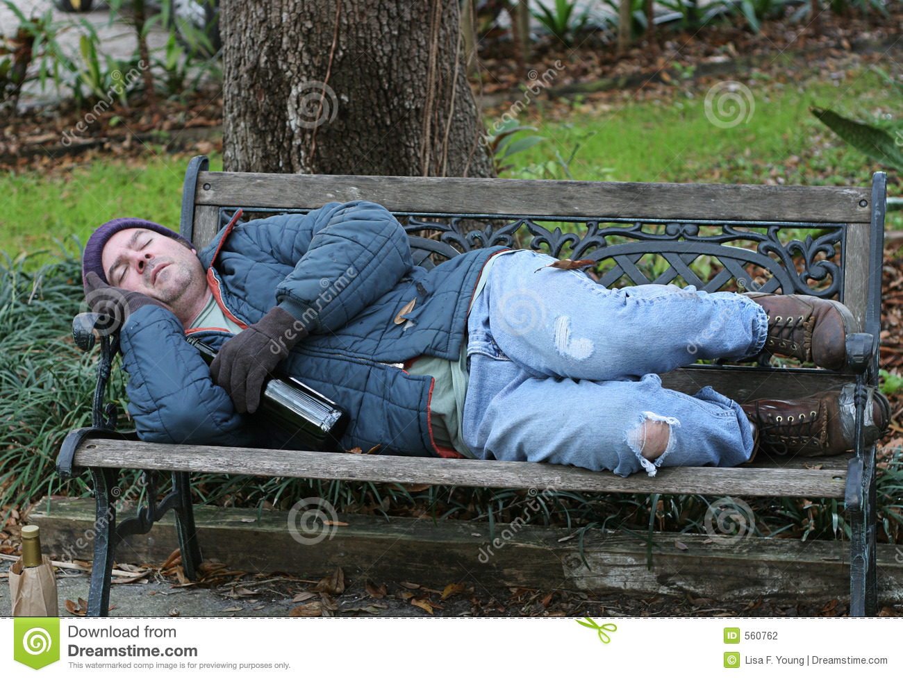 Homeless Man On Bench Full View Stock Photography