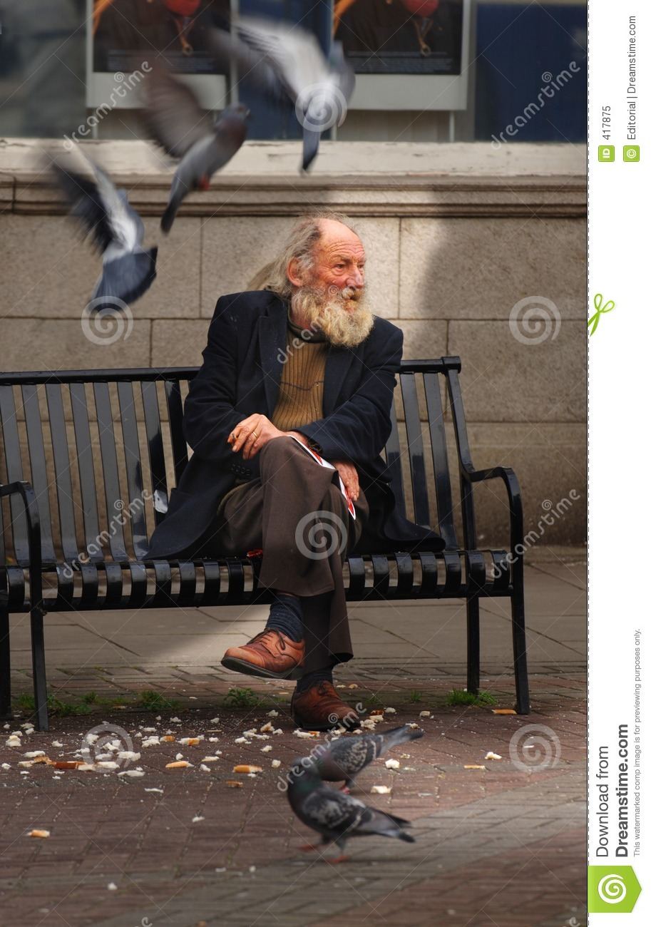 Royalty Free Stock Photo Homeless Man Feeding Pigeons
