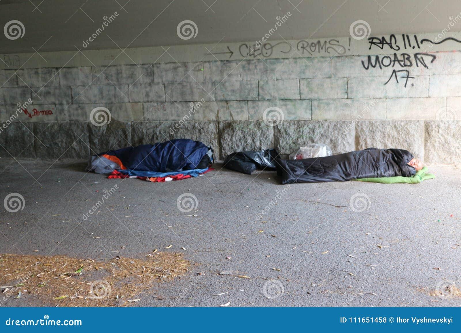 Homeless refugees sleeping in sleeping bags