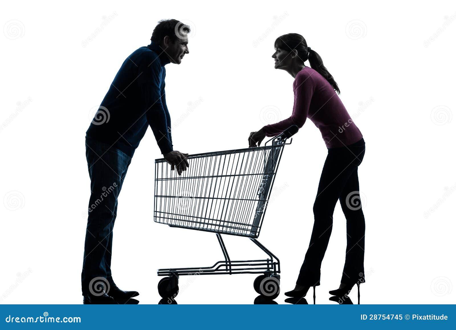 Homem da mulher dos pares com o carrinho de compras que data a silhueta flertando