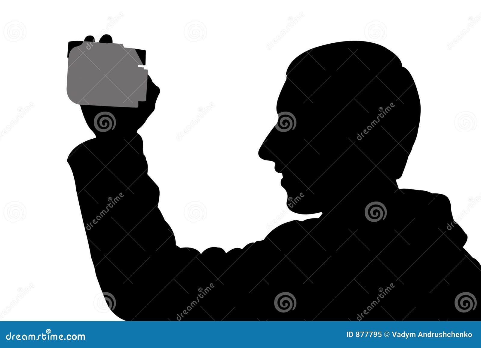 Homem da silhueta com digicam