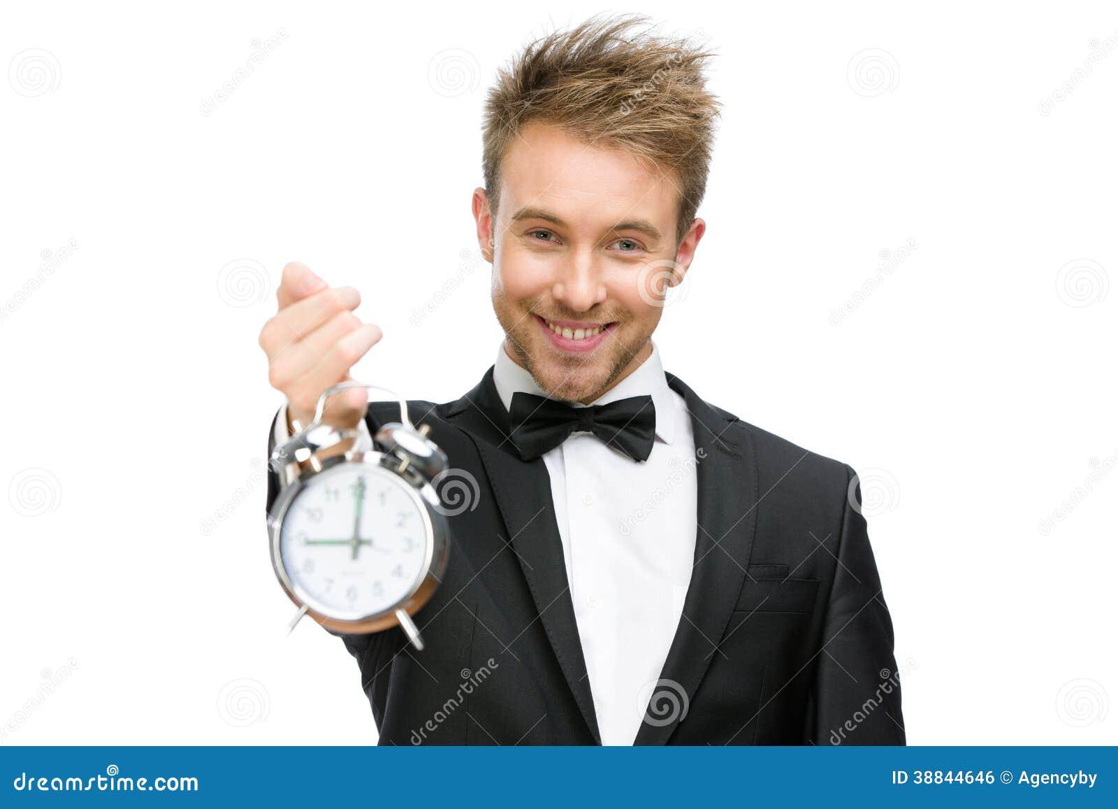 Homem de negócios que guarda o despertador