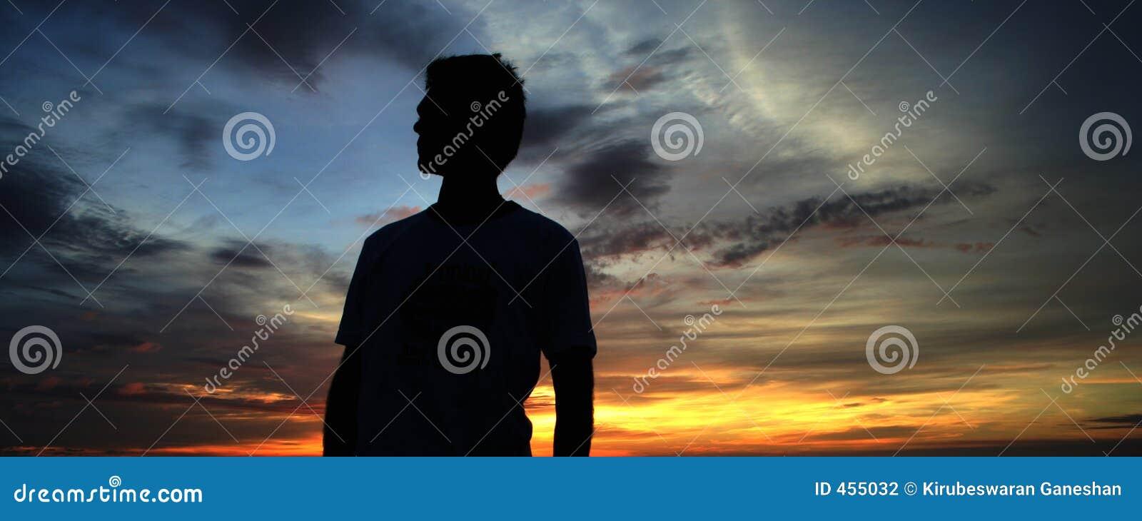 Homem e por do sol