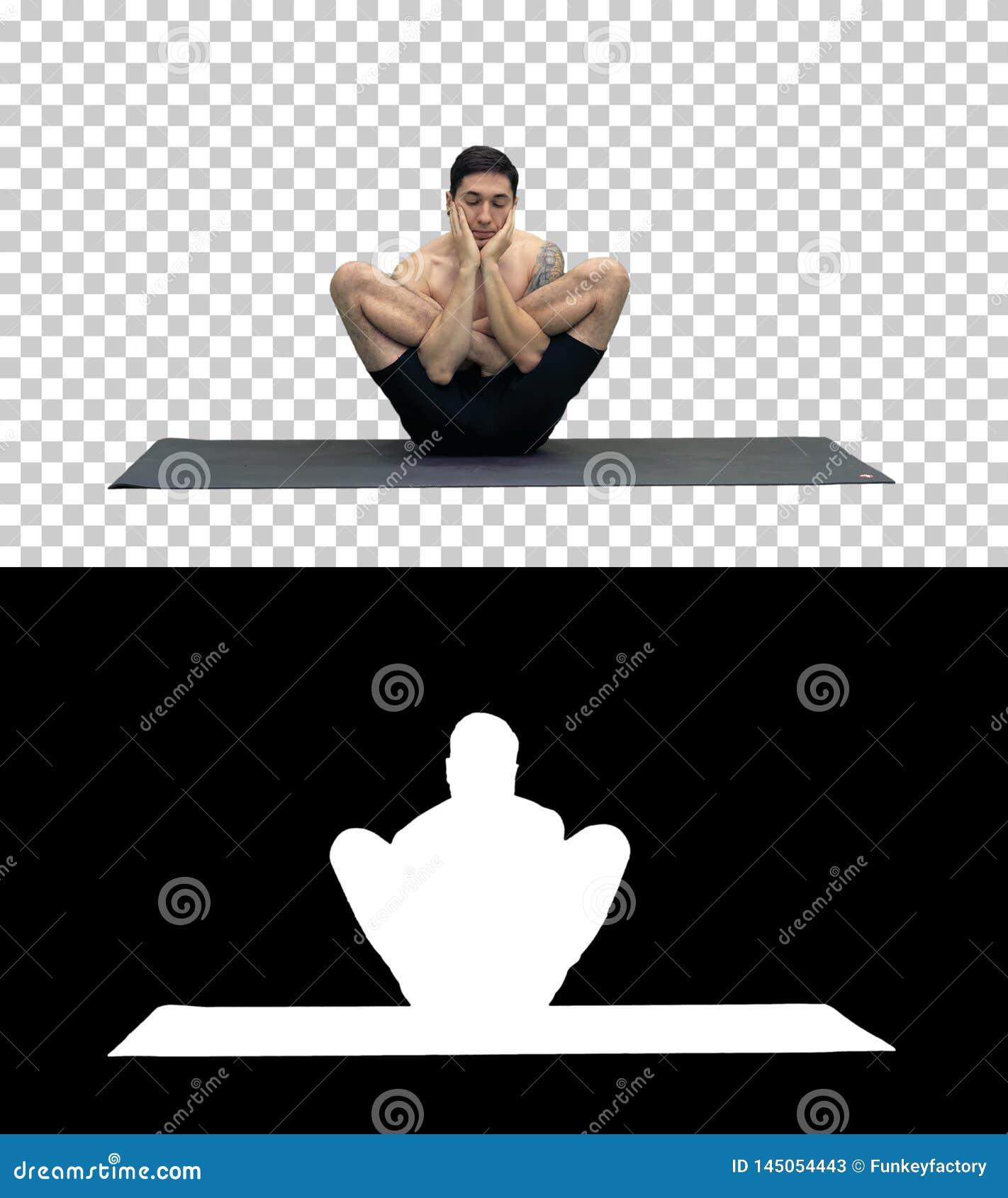 Homem novo consider?vel muscular que d? certo, ioga, l?tus, m?os na cara, Alpha Channel