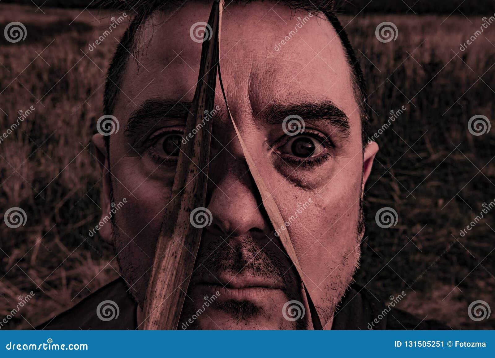 Homem sério com a folha sobre a cara