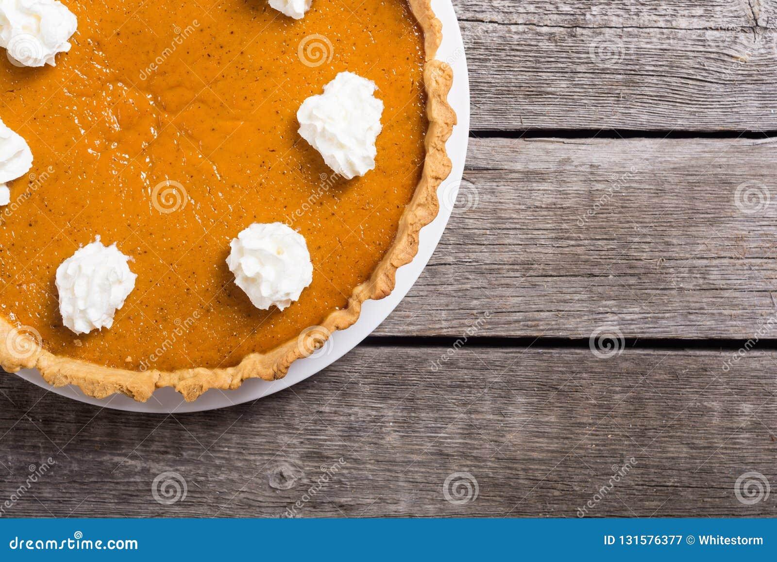 Homemade american traditional pumpkin pie Autumn food background