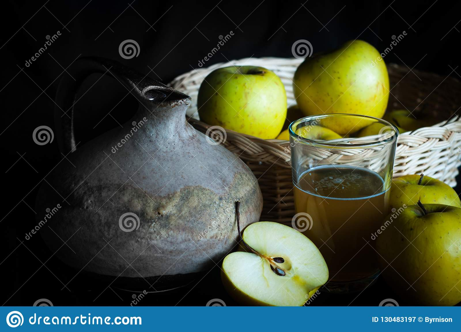 Homemade apple juice with ingredients and rustic jug