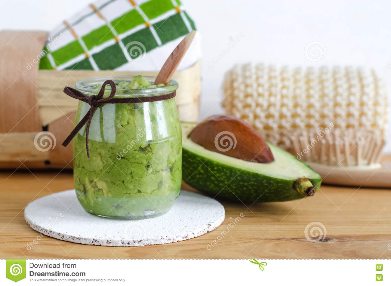 Homemade avocado mask. Prepared from mashed avocado and olive oil. Diy cosmetics.