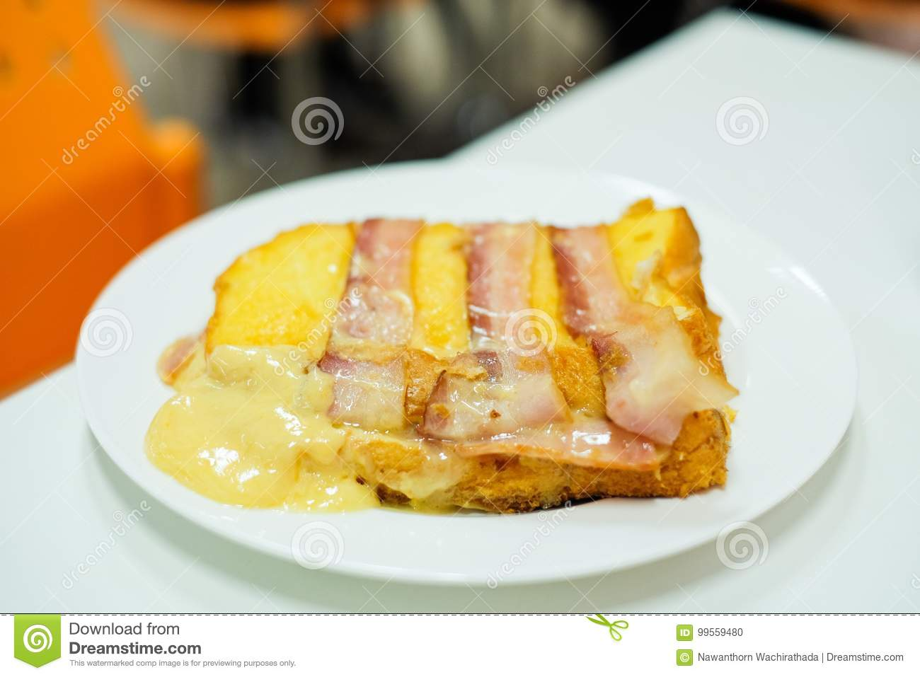 Homemade `Bacon and Ham put on bread with cheddar & mozzarella cheese` serve on