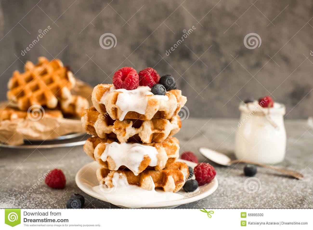Homemade Belgian waffles with forest fruits, blueberries, raspberries and yogurt.