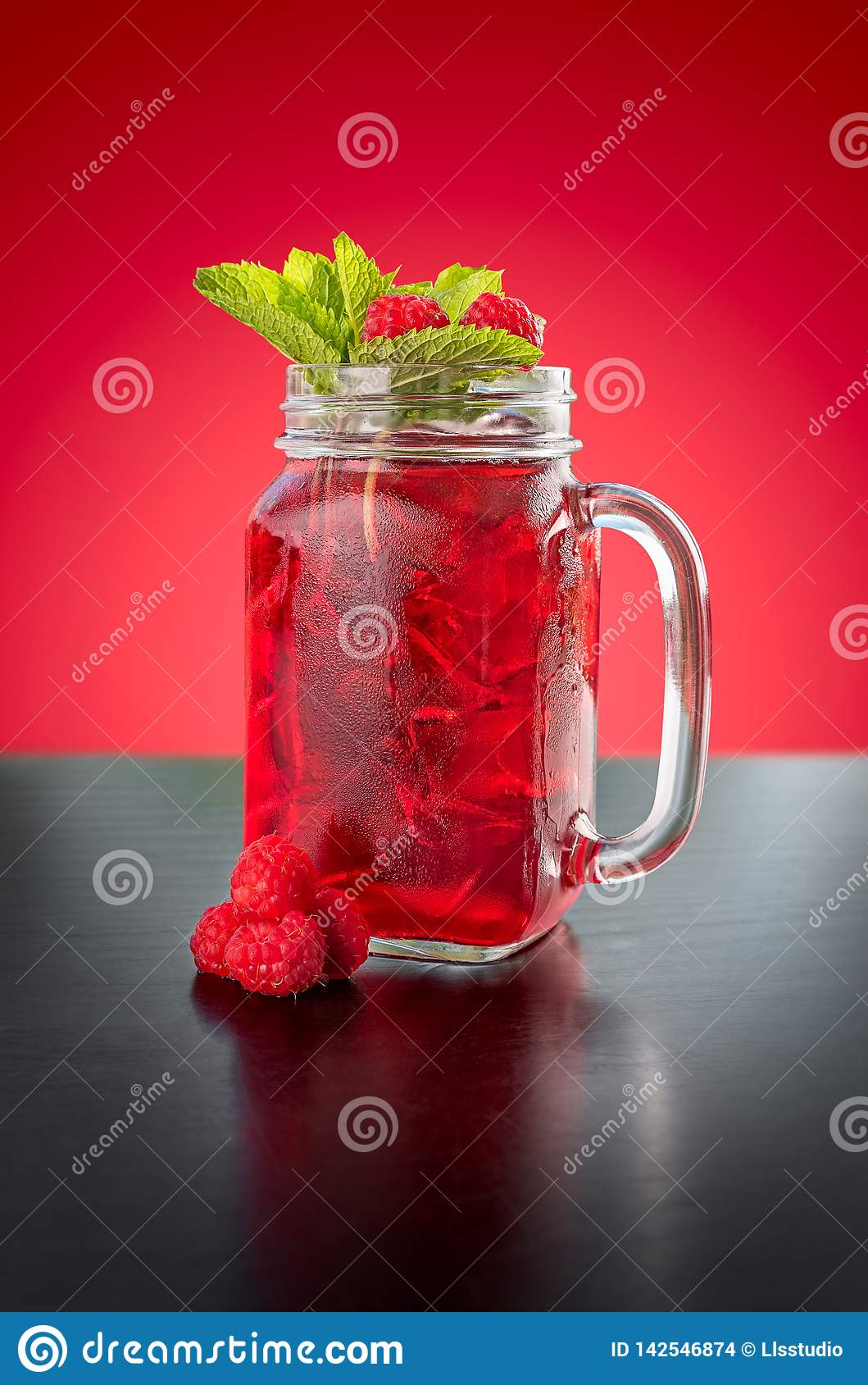 Homemade Berry Ice Tea in a glass jar.