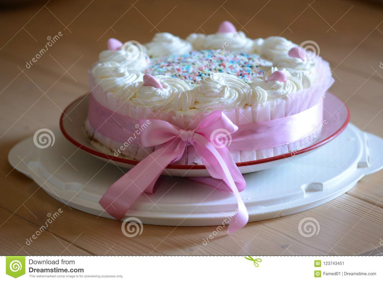 Homemade Birthday Cake With Pink Sugared Almonds And Whipped Cream