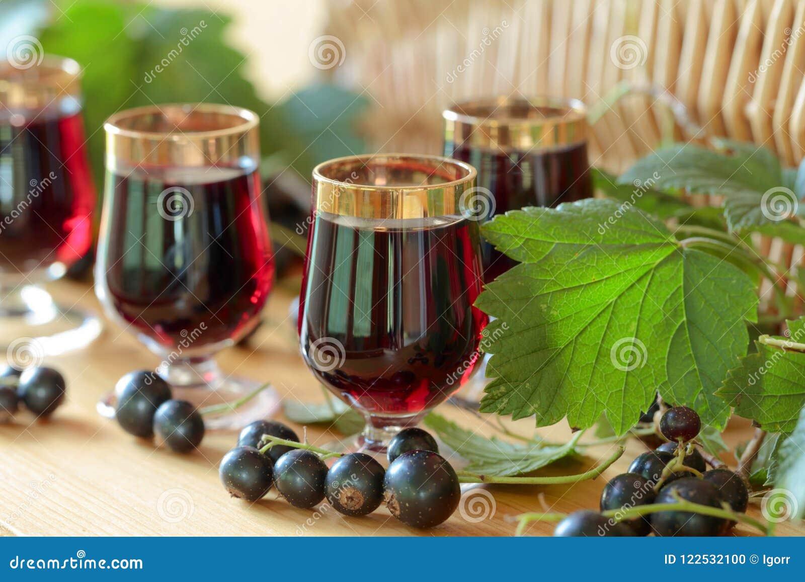 Homemade black currant liqueur and fresh berries.