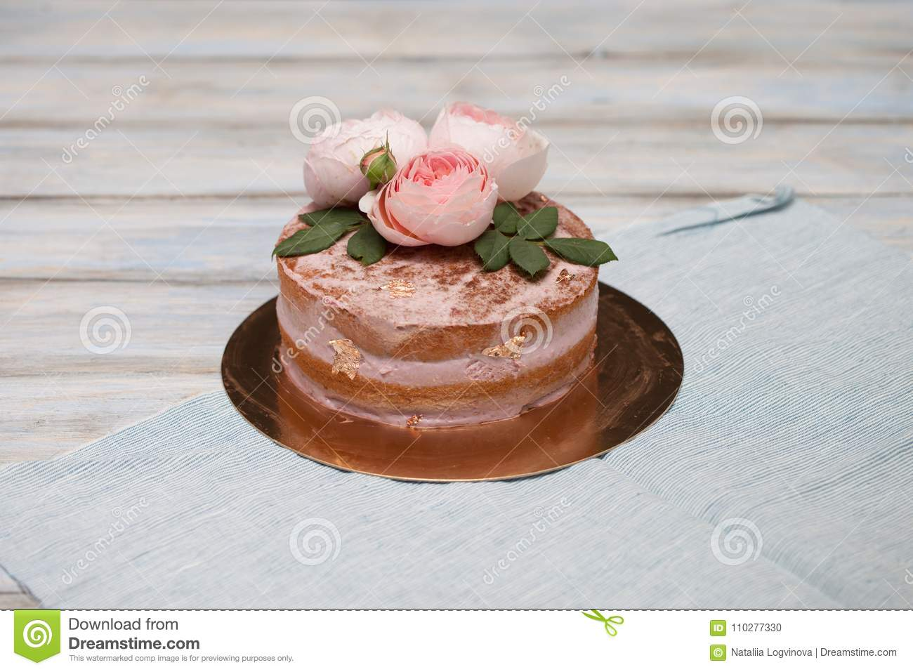 Homemade Buttercream Round Cake With Pink Rose Flowers On Top