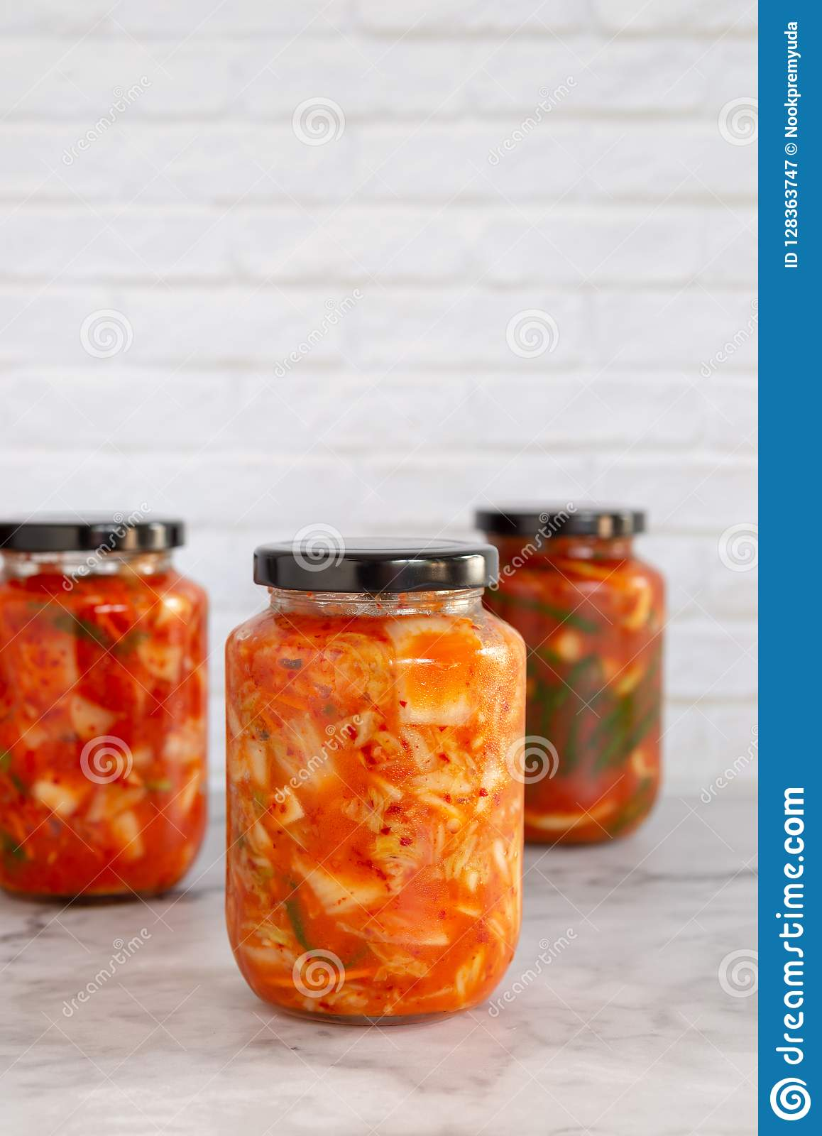 Variety homemade kimchi in a glass jars Winter canning food concept. Simple fermentation recipe.