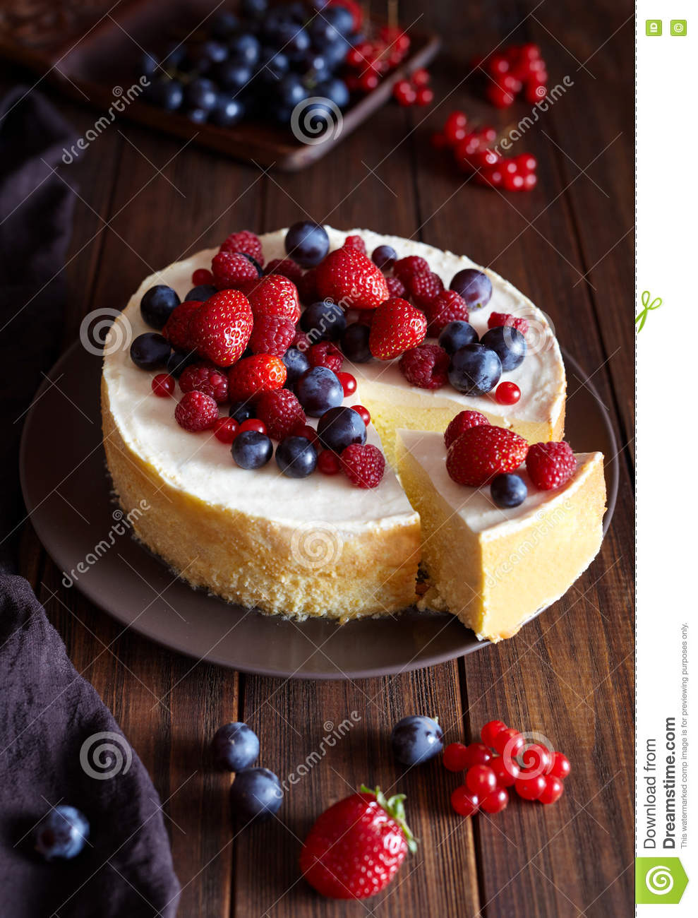 Homemade cheese cake with strawberry and winter berries. New York Cheesecake. Christmas dessert. Healthy food.