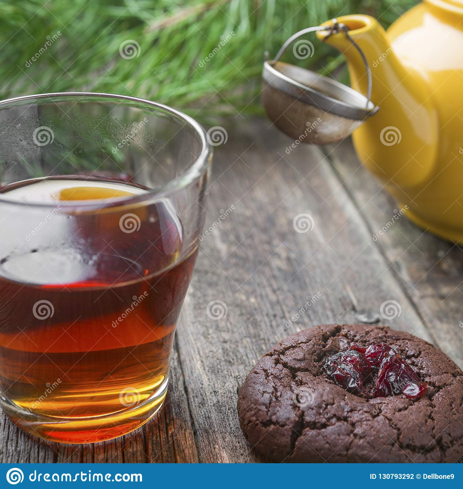 Homemade chocolate cookies with a glass cup of black tea