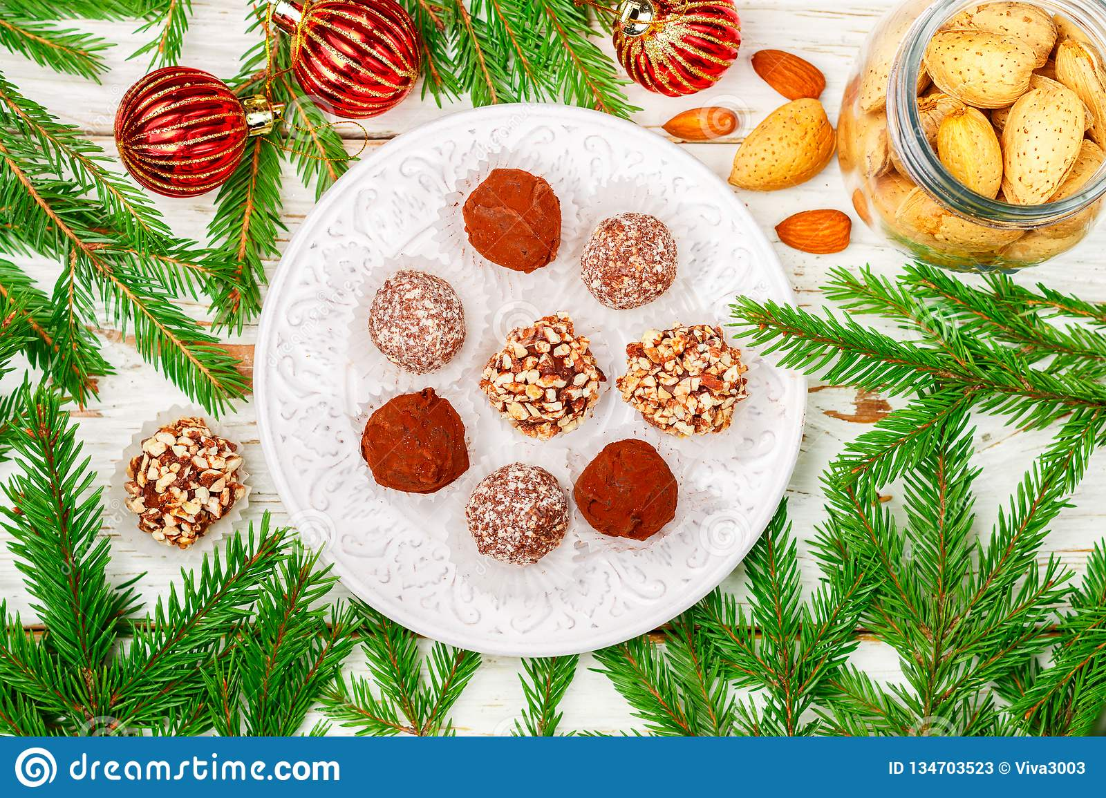 Homemade chocolate truffles with almonds, coconut and biscuits crumb in a white plate