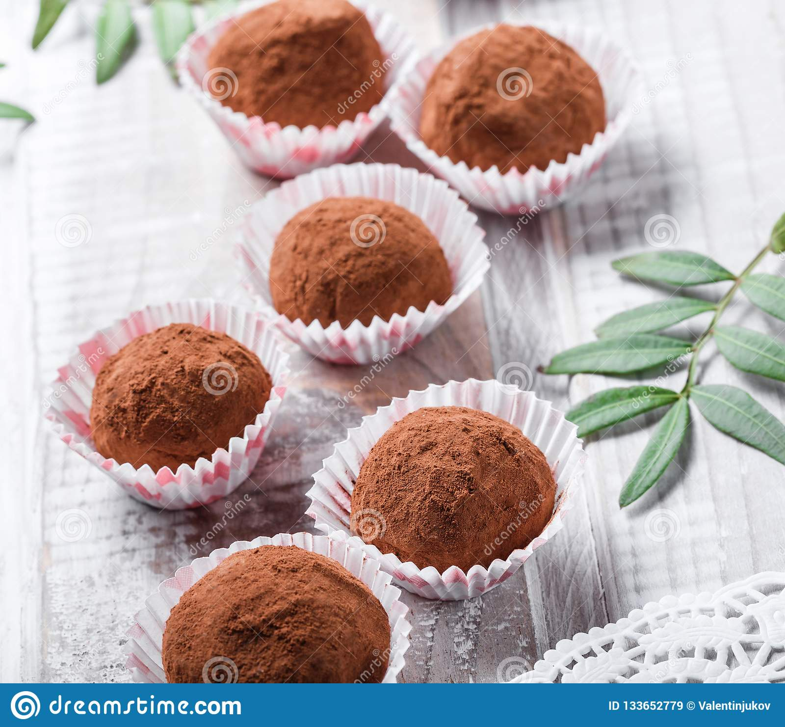 Homemade Chocolate truffles candy dessert on wooden background close up.