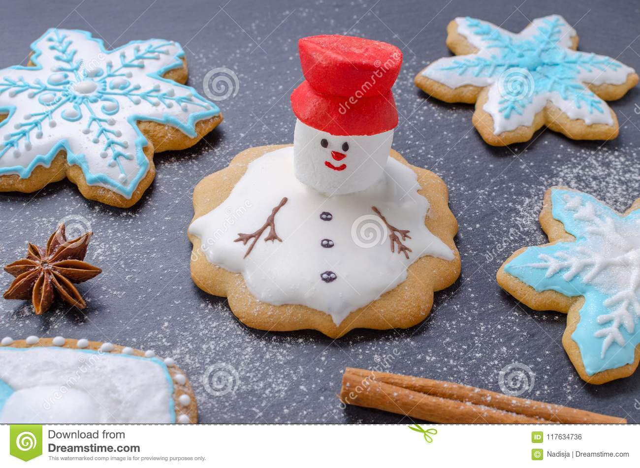 download homemade christmas cookies melted snowman with red hut and snowflake gingerbread stock photo - Homemade Christmas Cookies