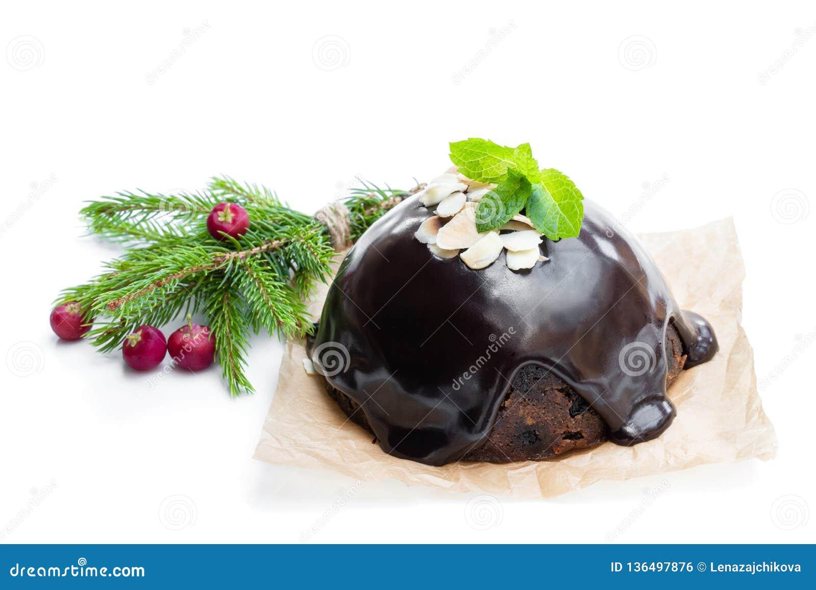Homemade Christmas pudding isolated on white