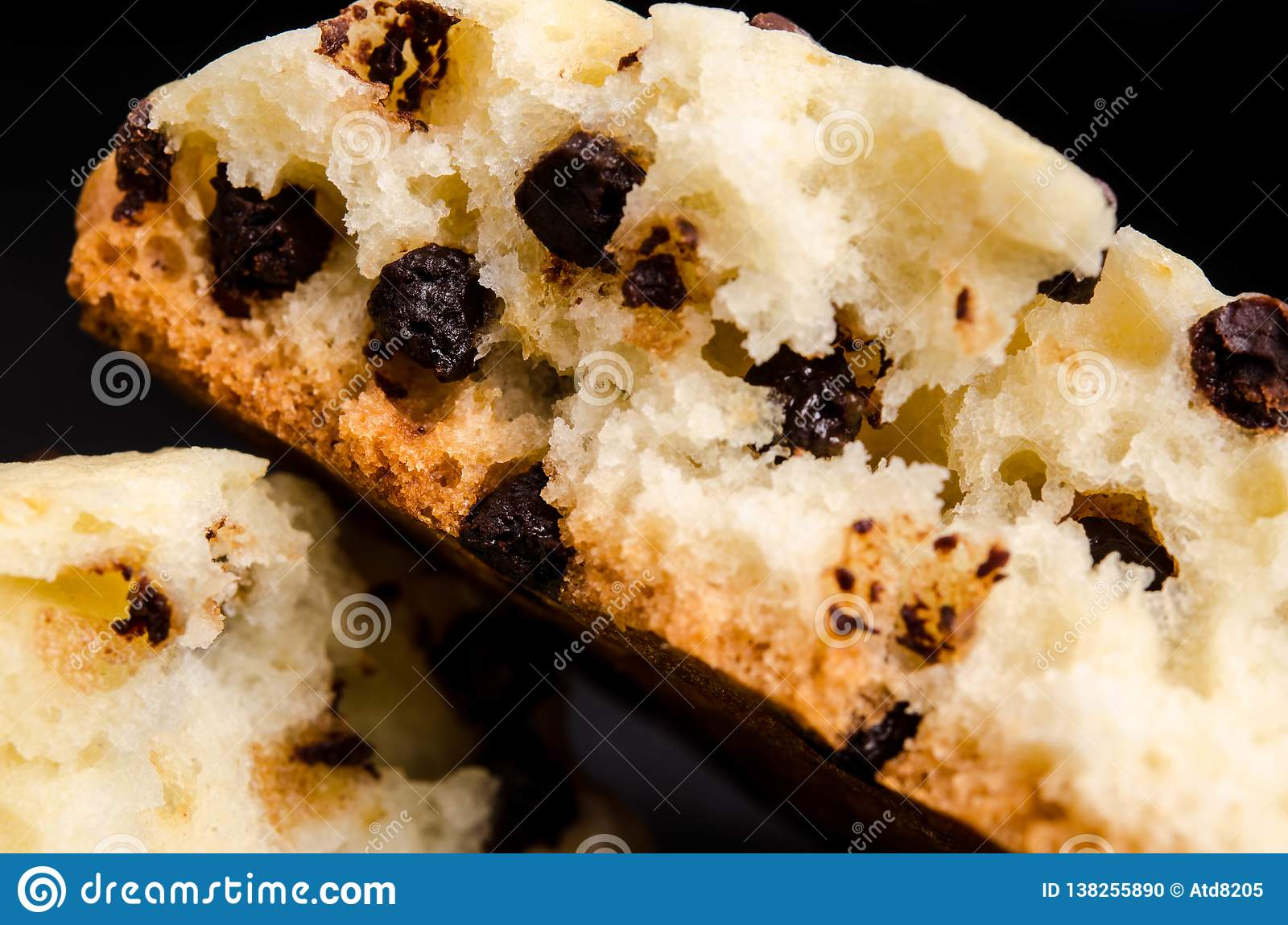 Homemade cookies with chocolate drops filling on a black background