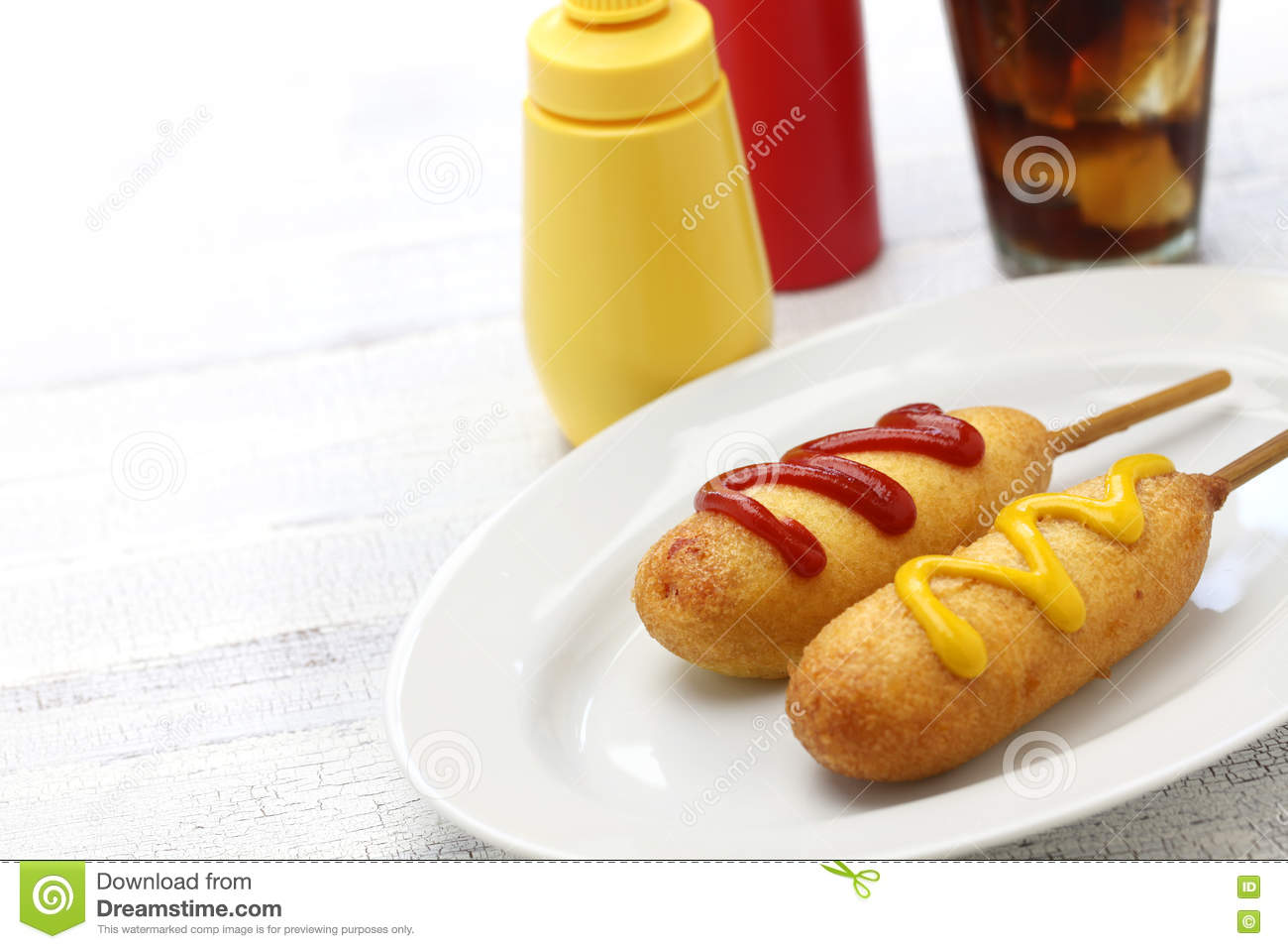 Homemade corn dogs and cola