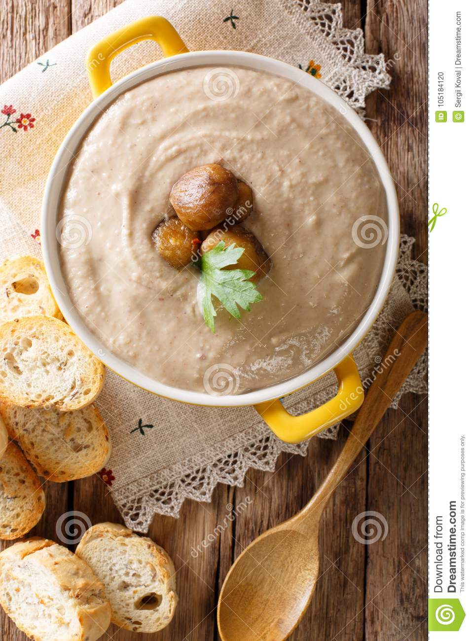 Homemade cream chestnut soup in a saucepan close-up. Vertical to