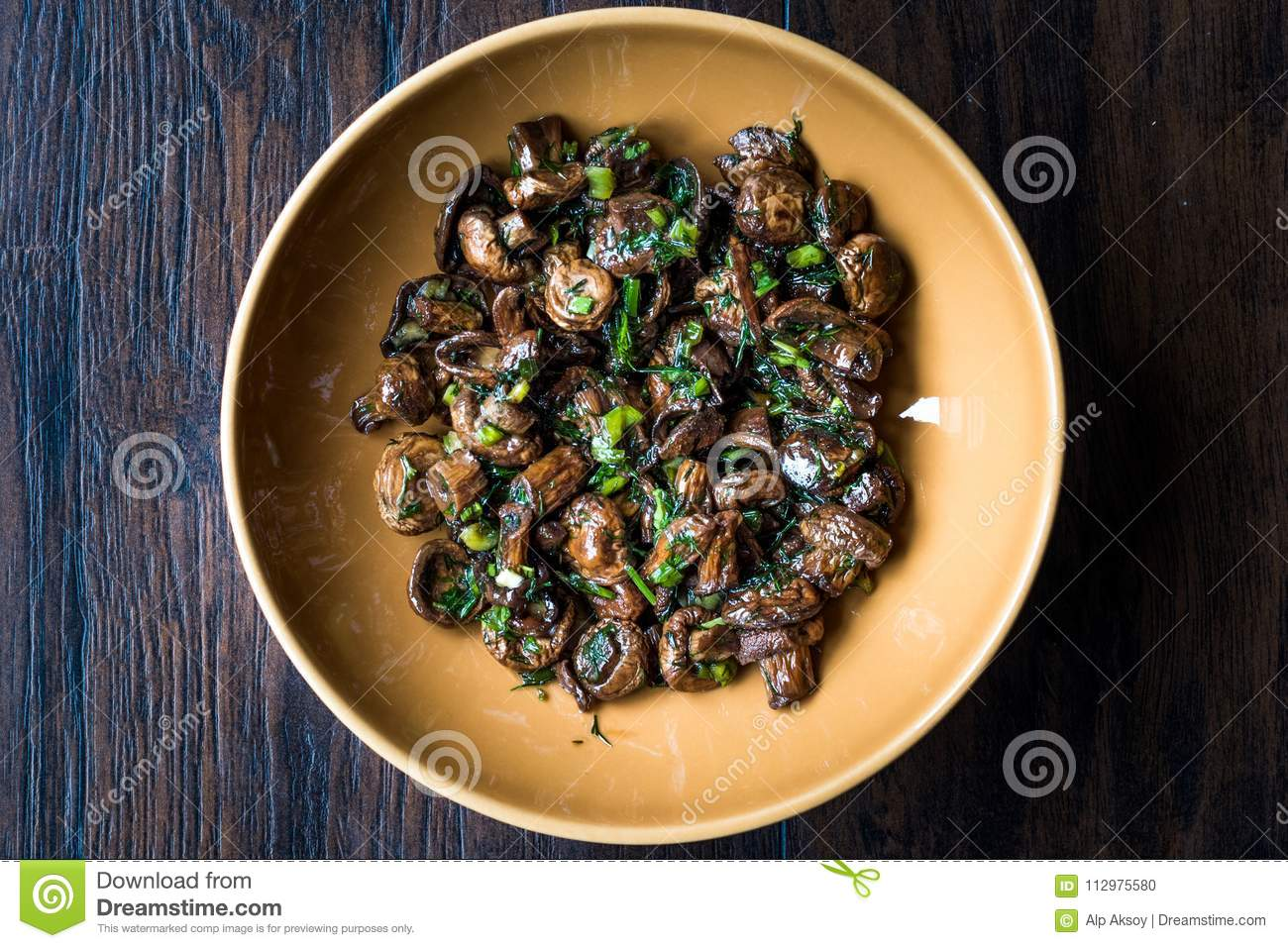 Homemade Cultivated Mushroom Salad with Dill and Green Onions.