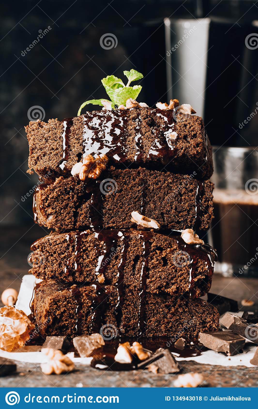 Homemade Dark Chocolate Brownies Topping With Nut Slices And Mint
