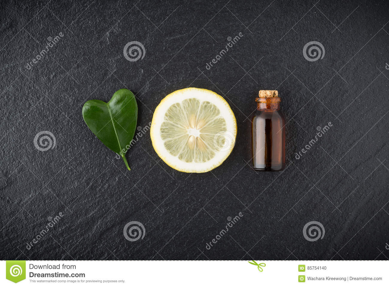 Homemade essential oil concept. Bottle essential oil with slice