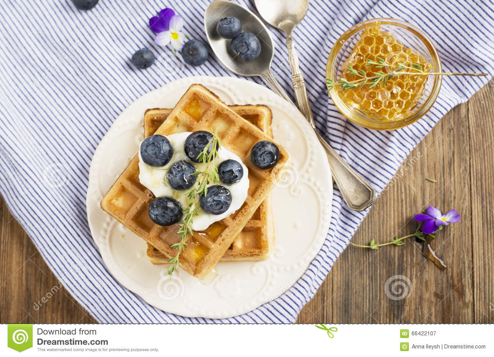 Homemade fresh crispy waffles for breakfast with blueberries