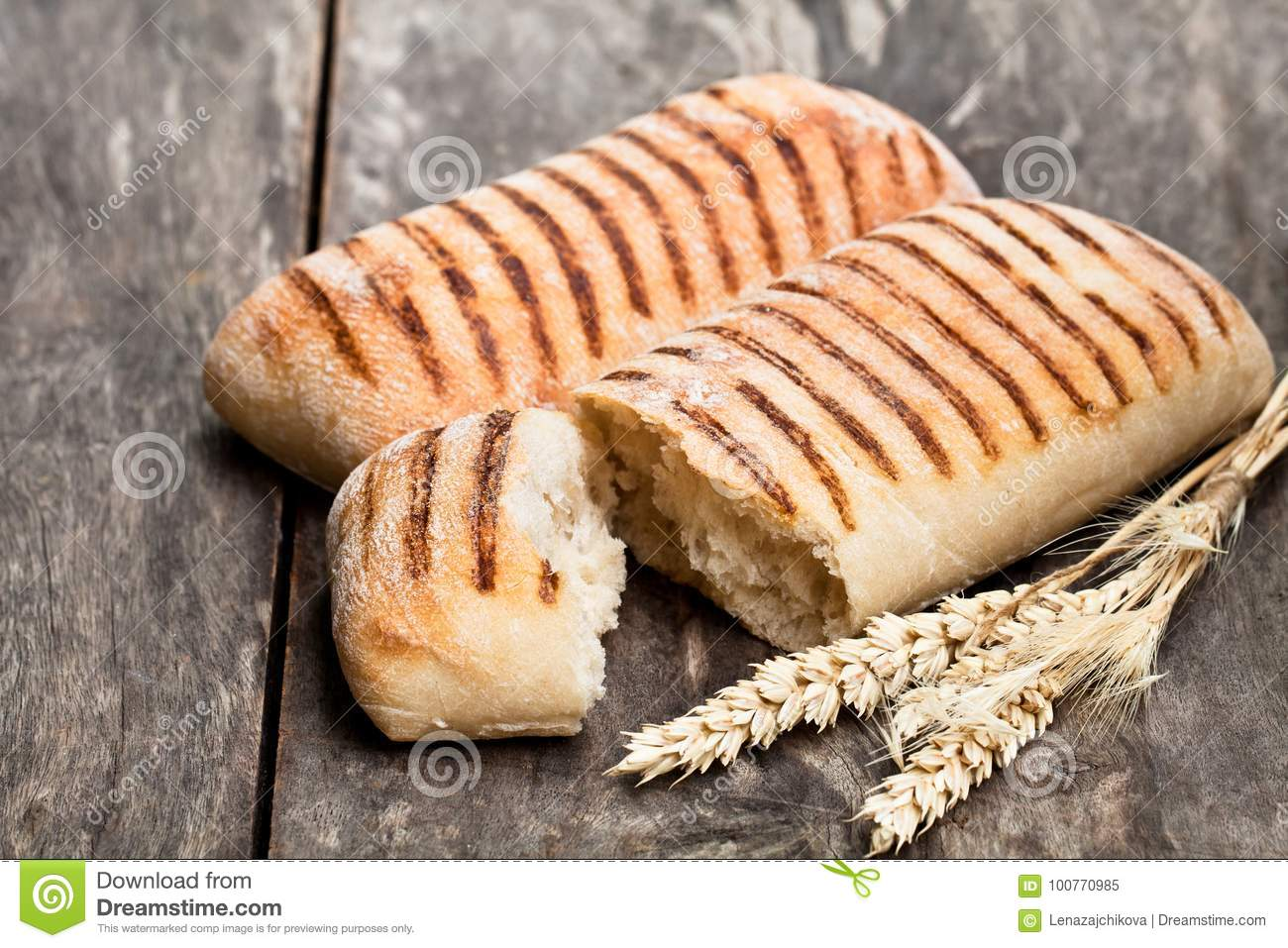 Homemade fresh panini bread on white