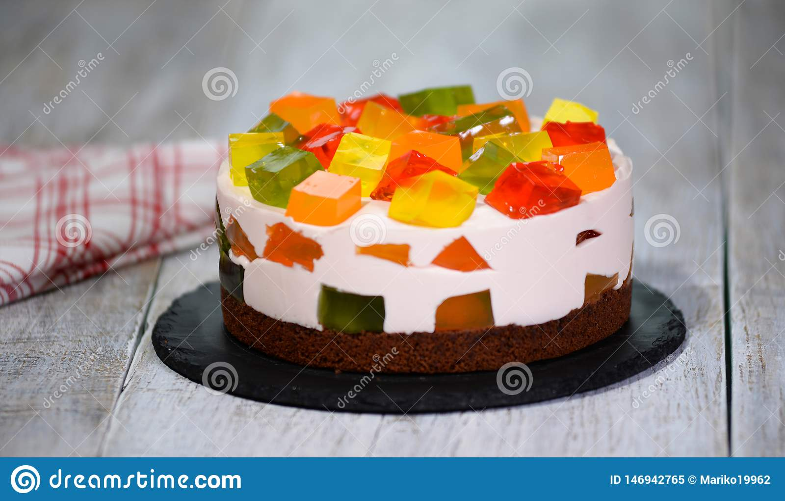 Homemade fruit dairy multi-colored jelly cake on a plate