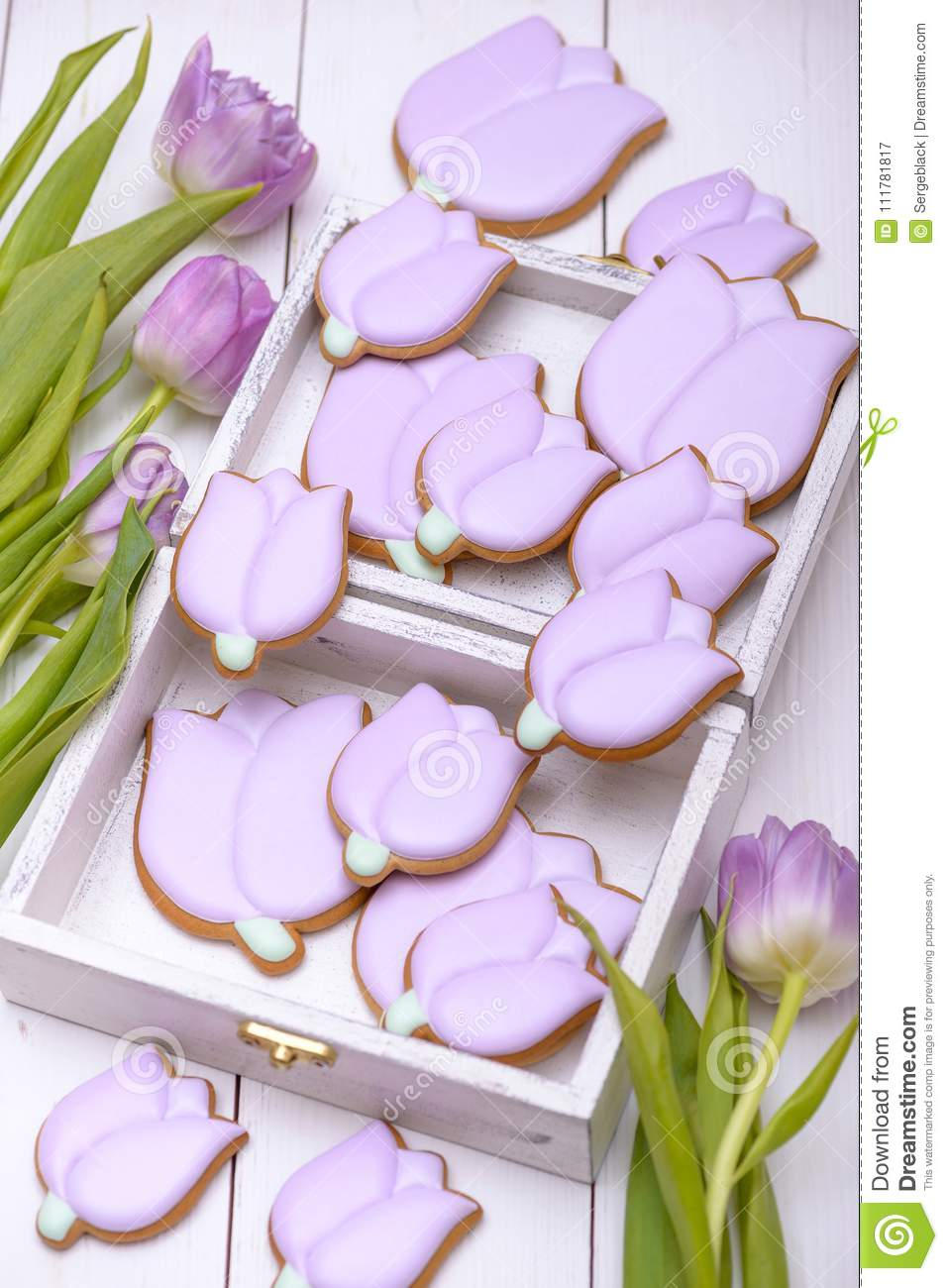 Homemade gingerbread cookies in the shape of purple tulip