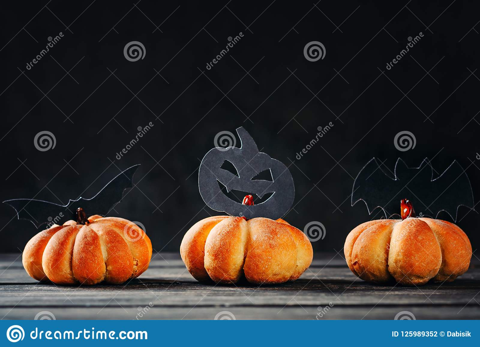 download homemade halloween cakes in the shape of pumpkin on dark background hallooween sweets stock