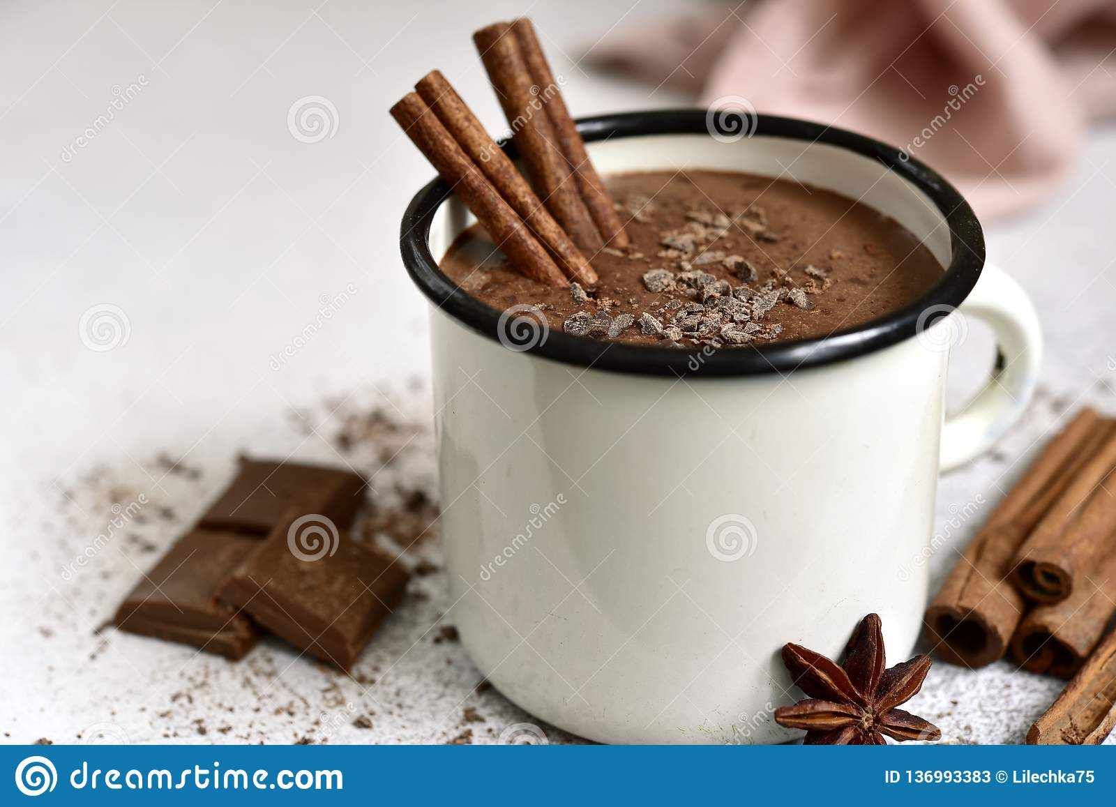 Homemade hot chocolate in a white enamel mug. On a light slate, stone or concrete background stock photos