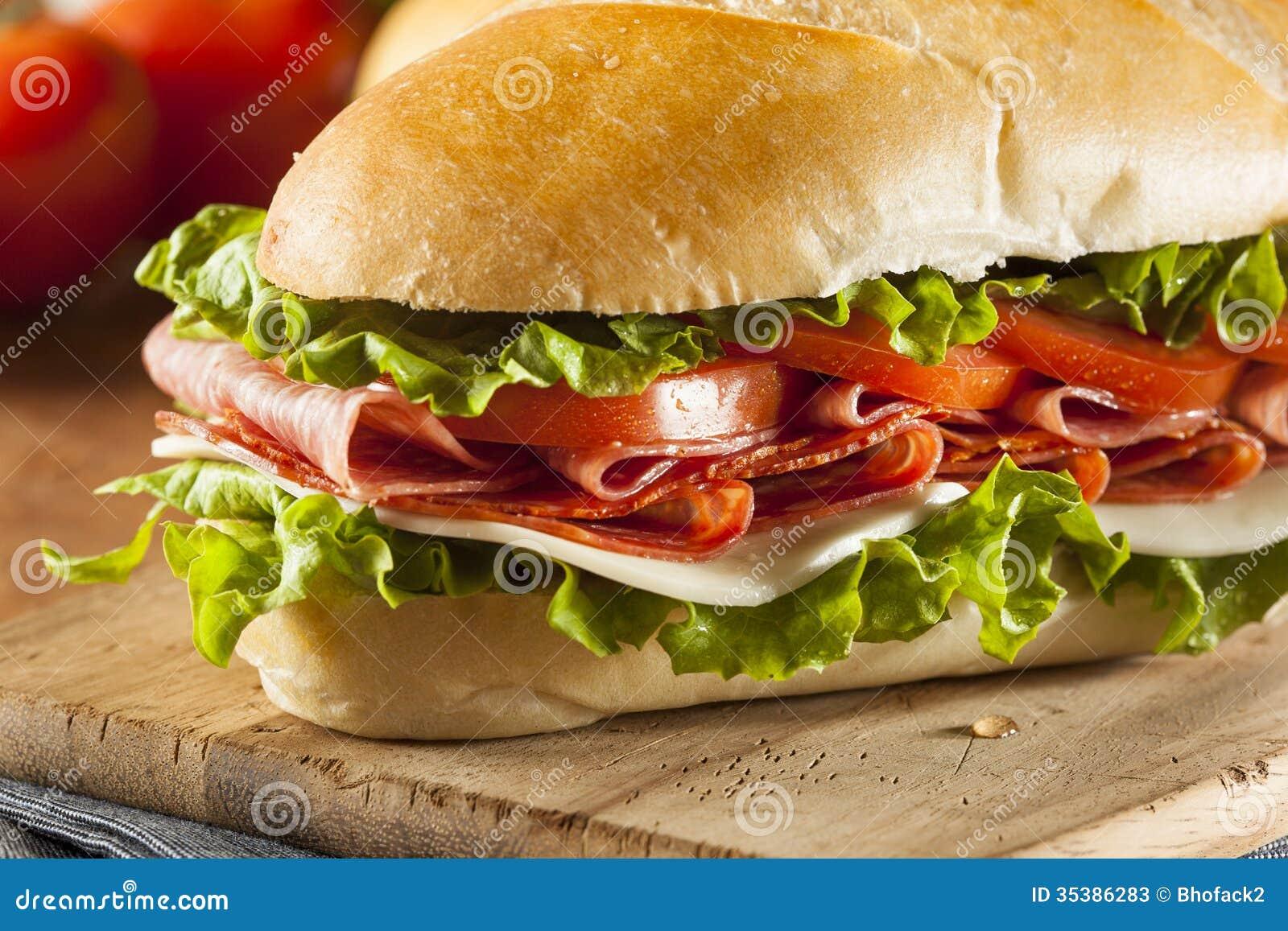 Homemade Italian Sub Sandwich with Salami, Tomato, and Lettuce.