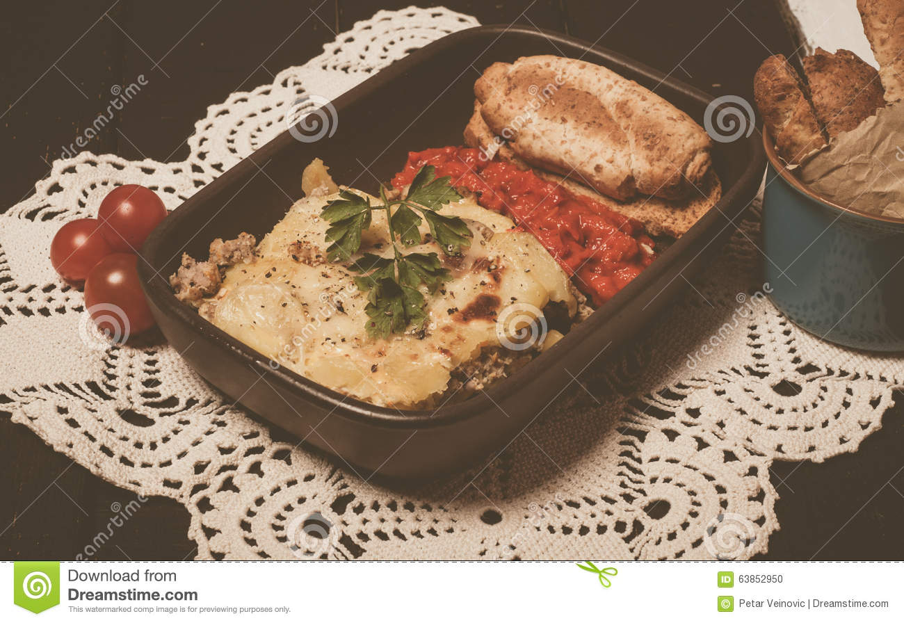 homemade moussaka served with bread and chutney east. Black Bedroom Furniture Sets. Home Design Ideas
